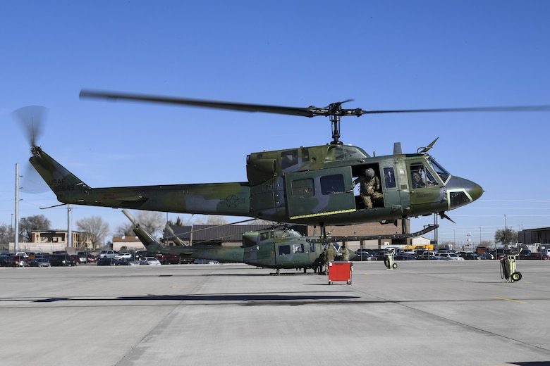 A UH-1N Huey with Maj. Gen. Mark E. Weatherington, Air Education and Training Command deputy commander, and crew members lifts-off the ground.