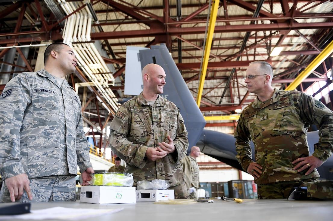 Airmen show deputy commander a new inovative tool.