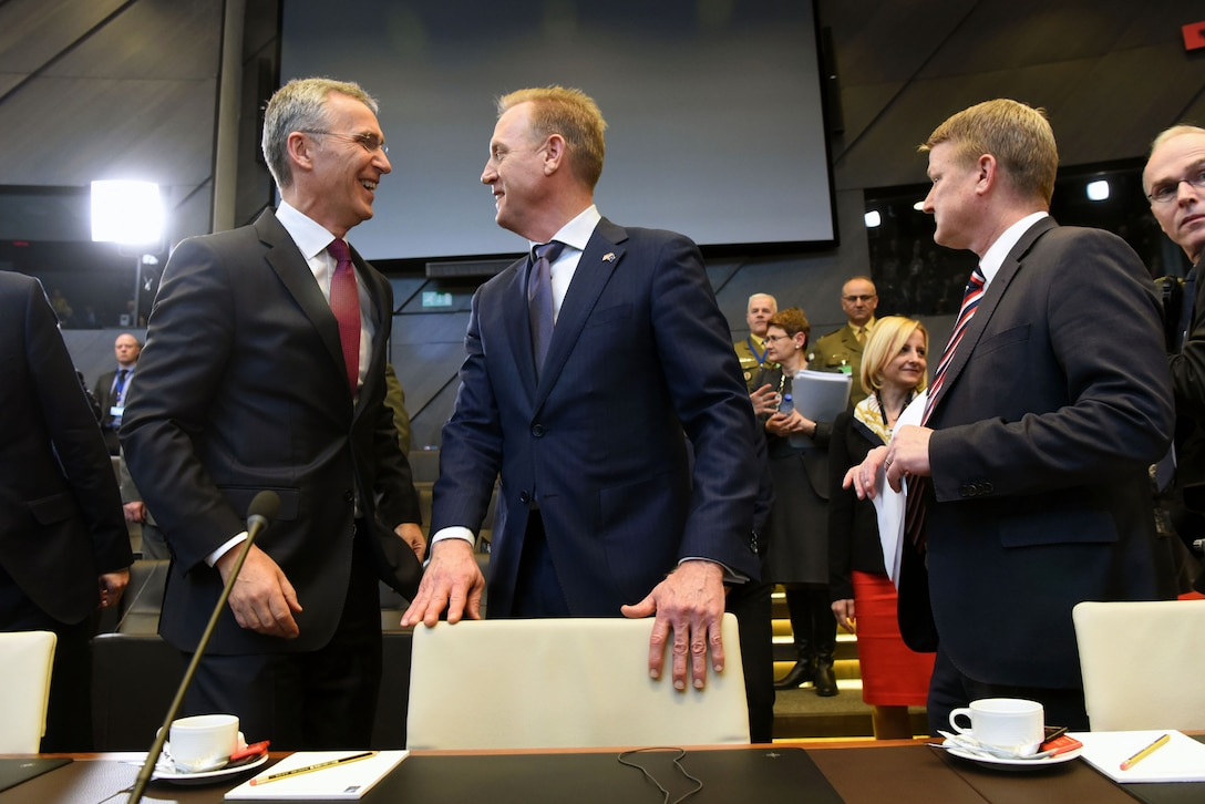 Acting Defense Secretary Patrick M. Shanahan talks with NATO Secretary General Jens Stoltenberg at NATO headquarters in Brussels.