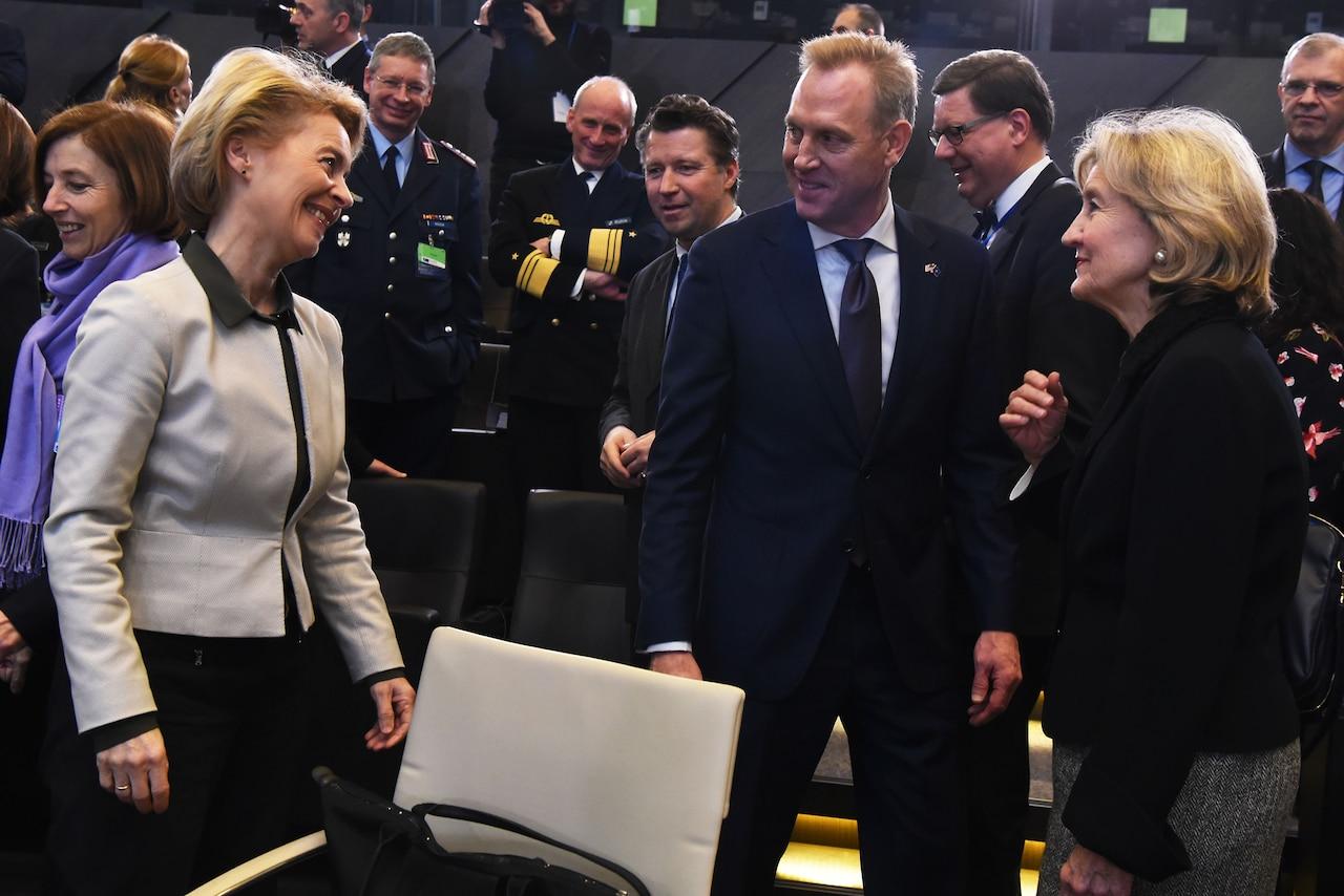 Acting Defense Secretary Patrick M. Shanahan talks with German Defense Minister Ursula von der Leyen, left, and U.S. Ambassador to NATO Kay Bailey Hutchison at NATO headquarters in Brussels.