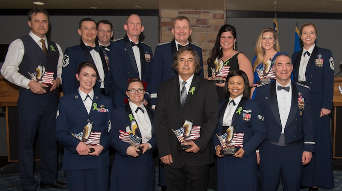2018 annual award winners pose for a photo, Feb. 9, 2019, on Holloman Air Force Base, N.M. During the banquet, 14 Holloman Airmen received awards for their outstanding performance throughout the year. (U.S. Air Force photo by Airman Quion Lowe)