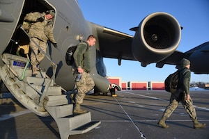 119th Wing unit members walk down the steps of a C-17 aircraft onto the flight line at the North Air National Guard Base, Fargo, N.D., as they return home from Exercise Southern Strike 19 Jan. 26, 2019. Southern Strike 19 is a total force, multi-service training exercise hosted by the Mississippi Air National Guard's Combat Readiness Training Center in Gulfport, Miss., and Camp Shelby Joint Forces Training Center near Hattiesburg, Miss. from Jan. 15 through Jan. 30, 2019.