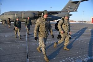119th Wing unit members walk across the flight line as the return home on a C-17 aircraft at the North Air National Guard Base, Fargo, N.D., from Exercise Southern Strike 19 Jan. 26, 2019. Southern Strike 19 is a total force, multi-service training exercise hosted by the Mississippi Air National Guard's Combat Readiness Training Center in Gulfport, Miss., and Camp Shelby Joint Forces Training Center near Hattiesburg, Miss. from Jan. 15 through Jan. 30, 2019.