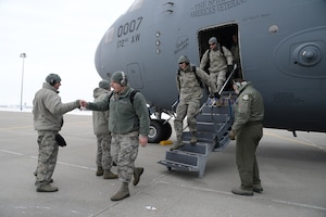119th Wing unit members walk down the steps of a C-17 aircraft onto the flight line at the North Air National Guard Base, Fargo, N.D., as they return home from Exercise Southern Strike 19 Feb. 1, 2019. Southern Strike 19 is a total force, multi-service training exercise hosted by the Mississippi Air National Guard's Combat Readiness Training Center in Gulfport, Miss., and Camp Shelby Joint Forces Training Center near Hattiesburg, Miss. from Jan. 15 through Jan. 30, 2019.