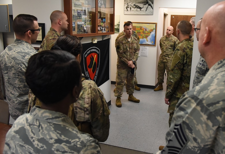 U.S. Air Force Tech. Sgt. Tyler Chambers, 81st Security Forces Squadron kennel master, welcomes leadership from the 81st Training Wing to the 81st SFS Military Working Dog Kennel Expo at Keesler Air Force Base, Mississippi, Feb. 11, 2019. The event, which is one of several in recognition of the Year Of The Defender, allowed the 81st SFS to showcase their training and mission capabilities to leadership from the 81st TRW. The expo included a daily MWD operations briefing, a MWD patrol scenario and a demonstration of veterinarian support provided to the MWDs. (U.S. Air Force photo by Kemberly Groue)