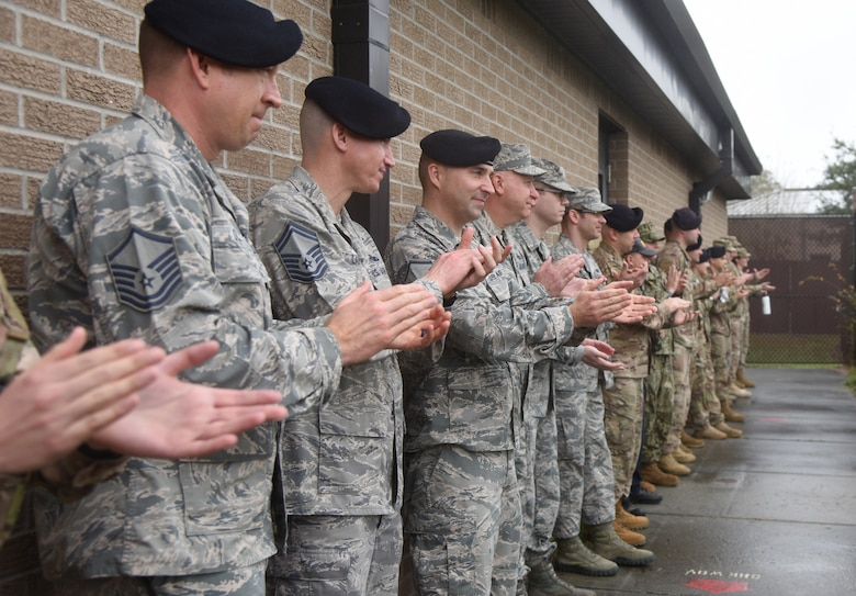 Keesler leadership and members of the 81st Security Forces Squadron applaud following a military working dog demonstration during the 81st SFS Military Working Dog Kennel Expo at Keesler Air Force Base, Mississippi, Feb. 11, 2019. The event, which is one of several in recognition of the Year Of The Defender, allowed the 81st SFS to showcase their training and mission capabilities to leadership from the 81st Training Wing. The expo included a daily MWD operations briefing, a MWD patrol scenario and a demonstration of veterinarian support provided to the MWDs. (U.S. Air Force photo by Kemberly Groue)