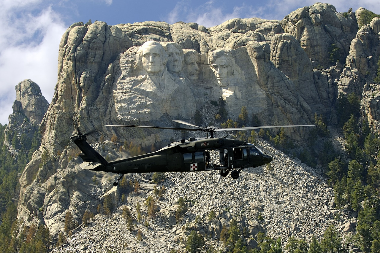 A helicopter flies past Mount Rushmore.