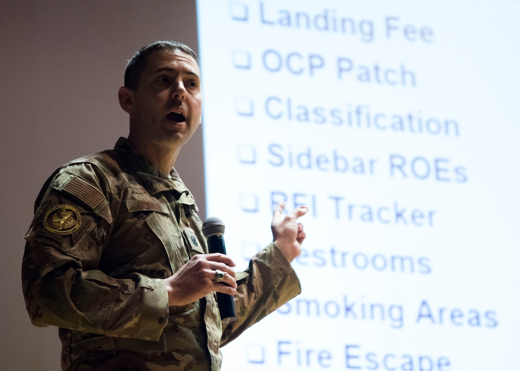 U.S. Air Force Lt. Col. Joseph Monaco, Air Mobility Command Mobility Guardian 2019 director, briefs MG19 International Planning Conference attendees at the base theater at Fairchild Air Force Base, Washington, Feb. 5, 2019.