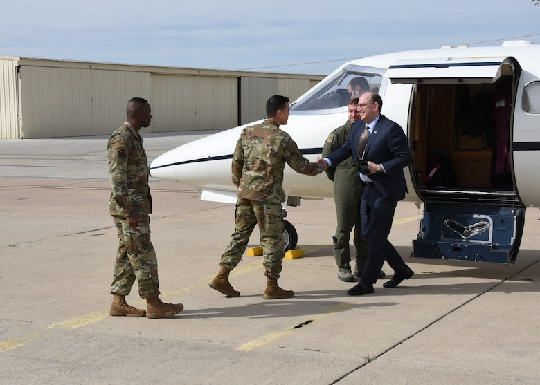 U.S. Air Force Col. Ricky Mills, 17th Training Wing commander, greets Under Secretary of the Air Force Matthew P. Donovan at Goodfellow Air Force Base, Texas, Feb. 13, 2019. Goodfellow was the first stop on Donovan's tour of Air Education Training Command bases to see how they build a lethal and ready force through innovation and training. (U.S. Air Force photo by Airman 1st Class Zachary Chapman/Released)