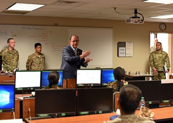 Under Secretary of the Air Force Matthew P. Donovan speaks to International Intelligence Applications Officers during his tour of Goodfellow Air Force Base, Texas, Feb. 13, 2019. The Air Force trains with our allies to build key relationships and share knowledge. (U.S. Air Force photo by Airman 1st Class Zachary Chapman/Released)