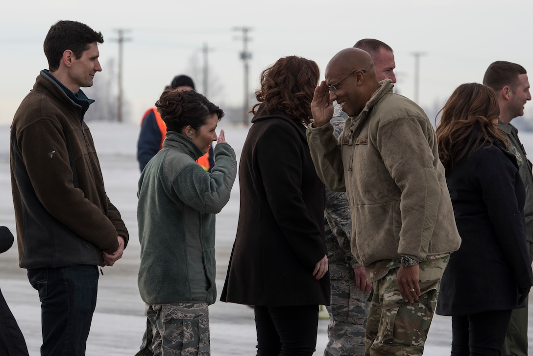 U.S. Air Force Gen. CQ Brown, Jr., Pacific Air Forces (PACAF) commander, exchanges a salute with Col. Patricia Csànk, Joint Base Elmendorf-Richardson (JBER) and 673d Air Base Wing commander, following his arrival at JBER, Alaska, Feb. 11, 2019. Brown visited JBER to meet with Airmen and to emphasize operational readiness. PACAF leadership toured various facilities throughout the installation to include the air traffic control tower, 517th Airlift Squadron and 962nd Airborne Air Control Squadron.