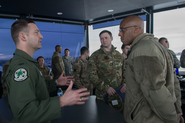 U.S. Air Force Col. Robert Davis, 3rd Wing commander, discusses Joint Base Elmendorf-Richardson's (JBER) mission capabilities with Gen. CQ Brown, Jr., Pacific Air Forces (PACAF) commander, during a tour of facilities at JBER, Alaska, Feb. 11, 2019. Brown visited JBER to meet with Airmen and to emphasize operational readiness. PACAF leadership toured various facilities throughout the installation to include the air traffic control tower, 517th Airlift Squadron and 962nd Airborne Air Control Squadron.