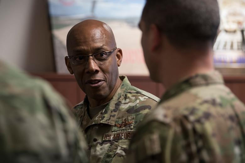U.S. Air Force Gen. CQ Brown, Jr., Pacific Air Forces (PACAF) commander, discusses PACAF mission readiness with an Airman from the 517th Airlift Squadron (AS) during a tour at Joint Base Elmendorf-Richardson (JBER), Alaska, Feb. 11, 2019. Brown visited JBER to meet with Airmen and to emphasize operational readiness. PACAF leadership toured various facilities throughout the installation to include the air traffic control tower, 517th AS and 962nd Airborne Air Control Squadron.