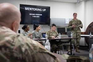 Senior Airman Joshua R. Swenk, 374th Logistics and Readiness Squadron ground transportation operator, speaks to senior enlisted leaders about curfew and dorm policies during the second annual Mentoring Up event, Feb. 7, 2018, at Yokota Air Base, Japan. Mentoring Up is a forum between Team Yokota's Chief's Group and Airmen to discuss issues and topics relative to the base with the goal to initiate new or improve upon existing programs in hopes that communication, morale, and retention efforts are more effective. (U.S. Air Force photo by Senior Airman Donald Hudson)