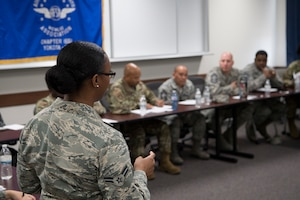Airman 1st Class Jayla T. Pressley, 374th Aerospace Medical Squadron public health technician, speaks to senior enlisted leaders about dining facility meal cards and the Yokota App during the second annual Mentoring Up event Feb. 7, 2018, at Yokota Air Base, Japan. The annual Mentoring Up event, sponsored by the Air Force Sergeants Association, is currently only offered at Yokota Air Base and has been such a success that Yokota's senior enlisted leaders are looking to hold the event more often. (U.S. Air Force photo by Senior Airman Donald Hudson)