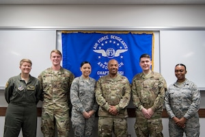 Chief Master Sgt. Elvin Young, 374th Airlift Wing command chief, poses for a photo with the participants of the second annual Mentoring Up event Feb Feb. 7, 2018, at Yokota Air Base, Japan. Mentoring up is sponsored by the Air Force Sergeants Association and provides a unique opportunity for ambitious Airmen who are leading their tier to present pressing matters and innovative ideas to senior enlisted leaders. (U.S. Air Force photo by Senior Airman Donald Hudson)