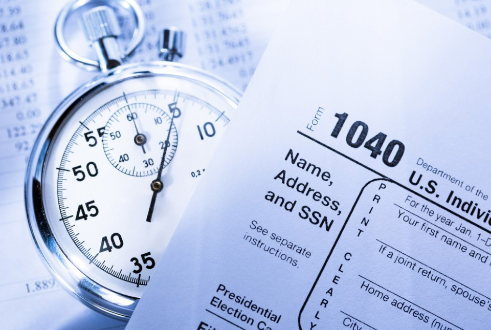 Tax form and stopwatch