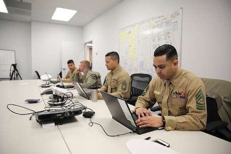 Marines with Marine Corps Recruiting Command G3 Team develop user stories for the Marine Corps Recruiting Information Support System II Feb. 8, in Stafford, Virginia. Marine Corps Systems Command has partnered with Marine Corps Recruiting Command to develop MCRISS II with the goal of making the job of recruiters a little easier. (U.S. Marine Corps photo by Joseph Neigh)