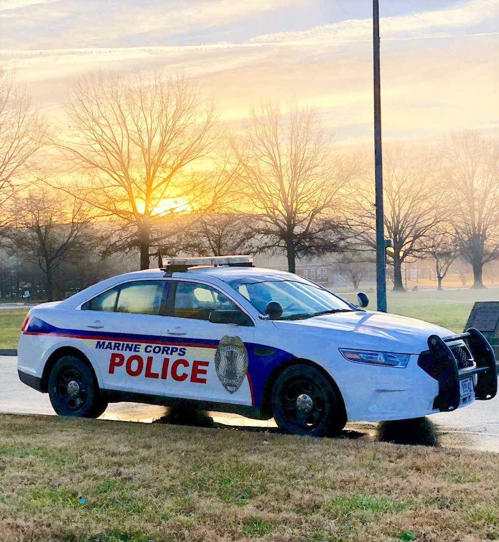 One of the Police cruisers that patrol Marine Corps Base Quantico parked in front of Lejeune Hall.