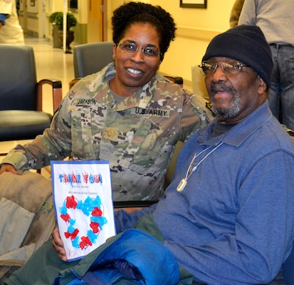 Army Maj. Andrea Jackson, a Medical division chief, left, poses with a patient waiting for care at the Corporal Michael J. Crescenz Veterans Affairs Medical Center, Feb. 11, 2019 in Philadelphia.