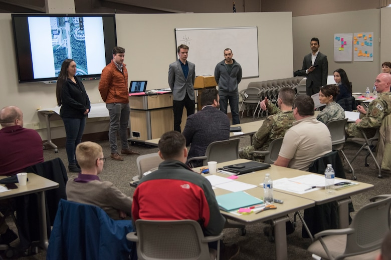 Teams present potential innovative solutions to the 673d Air Base Wing commander and leadership panel during an MD5 Boot Camp at Joint Base Elmendorf-Richardson, Alaska, Feb. 7, 2019. The intensive workshop hosted by the 673d Air Base Wing gave 40 innovators – service members and civilian employees from JBER and Eielson Air Force Base – an opportunity to focus on generating new ideas, nurturing talent and finding new applications of technology. Because of the course's interactive lecture series and unique design, attendees were able to strategize viable solutions addressing one of the commander's top priorities in less than four days.