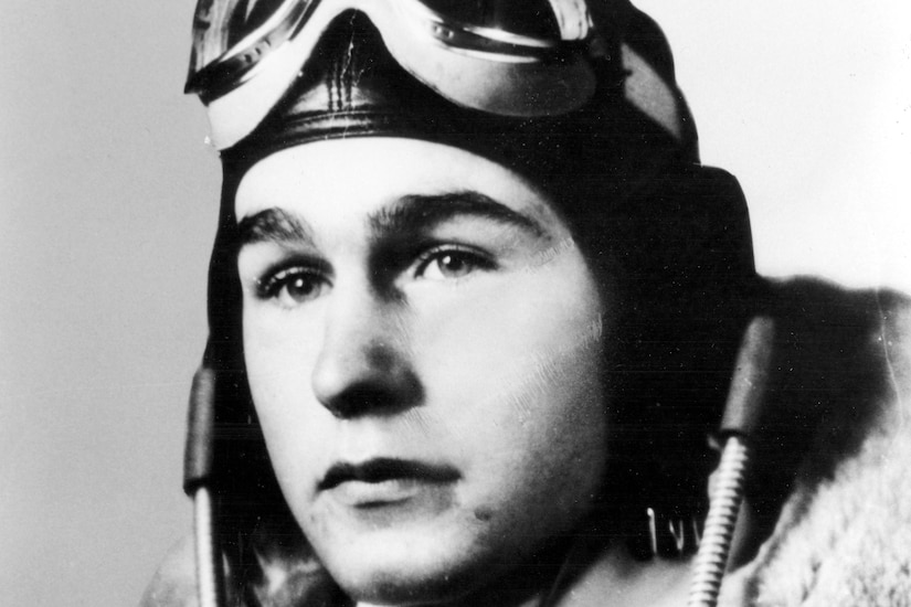 An official photo of a young George H.W. Bush in flight gear