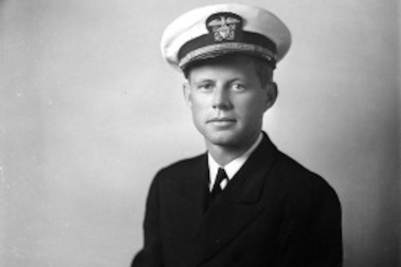 An official photo of John F. Kennedy in his naval dress uniform