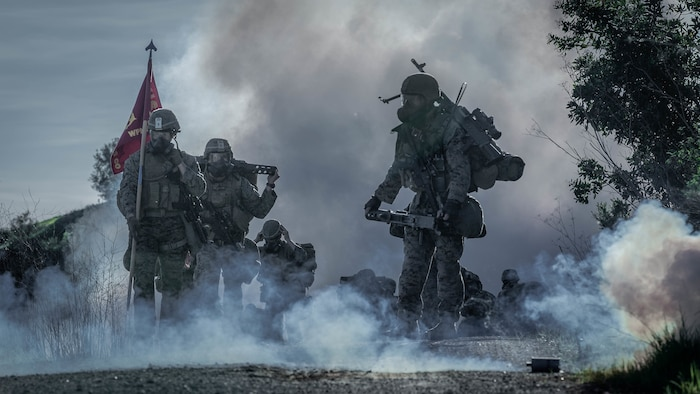U.S. Marines with 1st Battalion, 1st Marine Regiment, 1st Marine Division, hike through a simulated chemical attack at Marine Corps Base Camp Pendleton, California, Jan. 12, 2019.