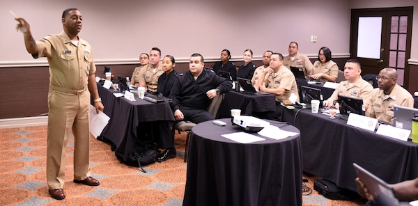 Chief Petty Officer Kevin Jones, a trainer assigned to Navy Recruiting District San Antonio, provides market development training to recruiters of NRD's and Navy Talent Acquisition Groups during a Leading Petty Officers Course held at the Double Tree Hotel.