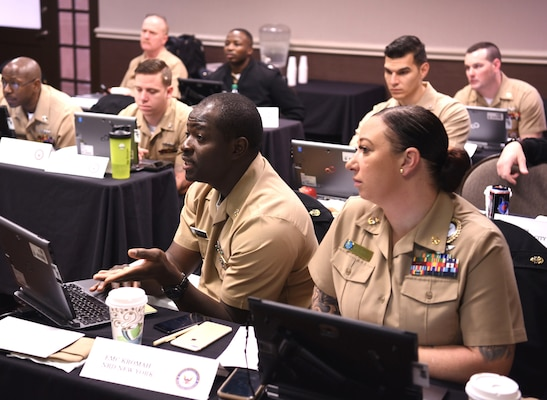 Chief Petty Officer Kelelu Kromah, a recruiter assigned to Navy Recruiting District New York, joined by Chief Petty Officer Alexis Danet, assigned to NRD Miami, shares his prospecting plan with Navy Recruiting Command's National Training and Quality Assurance Team during a Leading Petty Officers (LPO) Course held at the Double Tree Hotel.