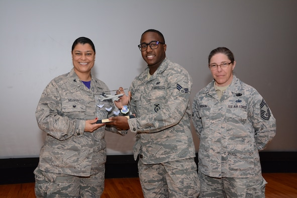 Col. Dana Nelson, 507th Air Refueling Wing Vice Commander, and Chief Master Sgt. Julie Hudson, 507th Mission Support Group superintendent, present the Airman of the 4th Quarter 2018 Award to Senior Airman Shannon Glover, 507th Security Forces Squadron, Feb. 10, 2019, at Tinker Air Force Base, Oklahoma. (U.S. Air Force photo by Tech. Sgt. Samantha Mathison)