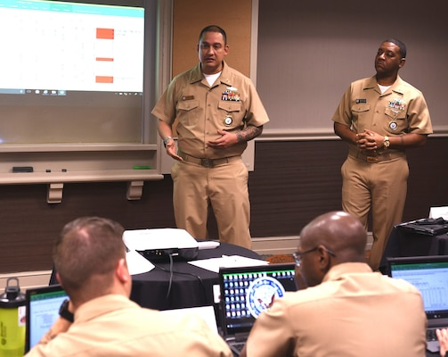Chief Petty Officer Christian Torres (left), an accessor instructor assigned to Navy Recruiting Command's National Training and Quality Assurance Team, joined by Chief Petty Officer Kevin Jones of Chicago, a trainer assigned to Navy Recruiting District San Antonio, provides instruction on building a targeted prospecting plan to recruiters of NRD's and Navy Talent Acquisition Groups during a Leading Petty Officers (LPO) Course held at the Double Tree Hotel.