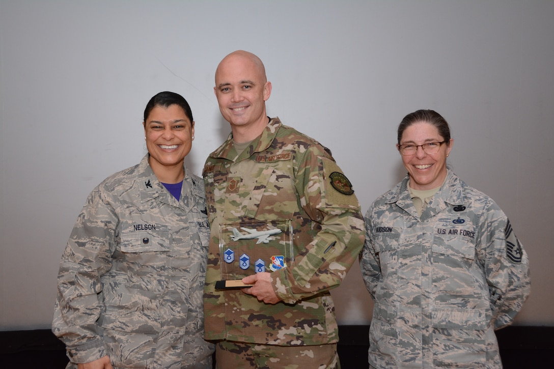 Col. Dana Nelson, 507th Air Refueling Wing Vice Commander, and Chief Master Sgt. Julie Hudson, 507th Mission Support Group superintendent, present the Senior NCO of the 4th Quarter 2018 Award to Senior Master Sgt. Justin Henry, 507th Aircraft Maintenance Squadron, Feb. 10, 2019, at Tinker Air Force Base, Oklahoma. (U.S. Air Force photo by Tech. Sgt. Samantha Mathison)