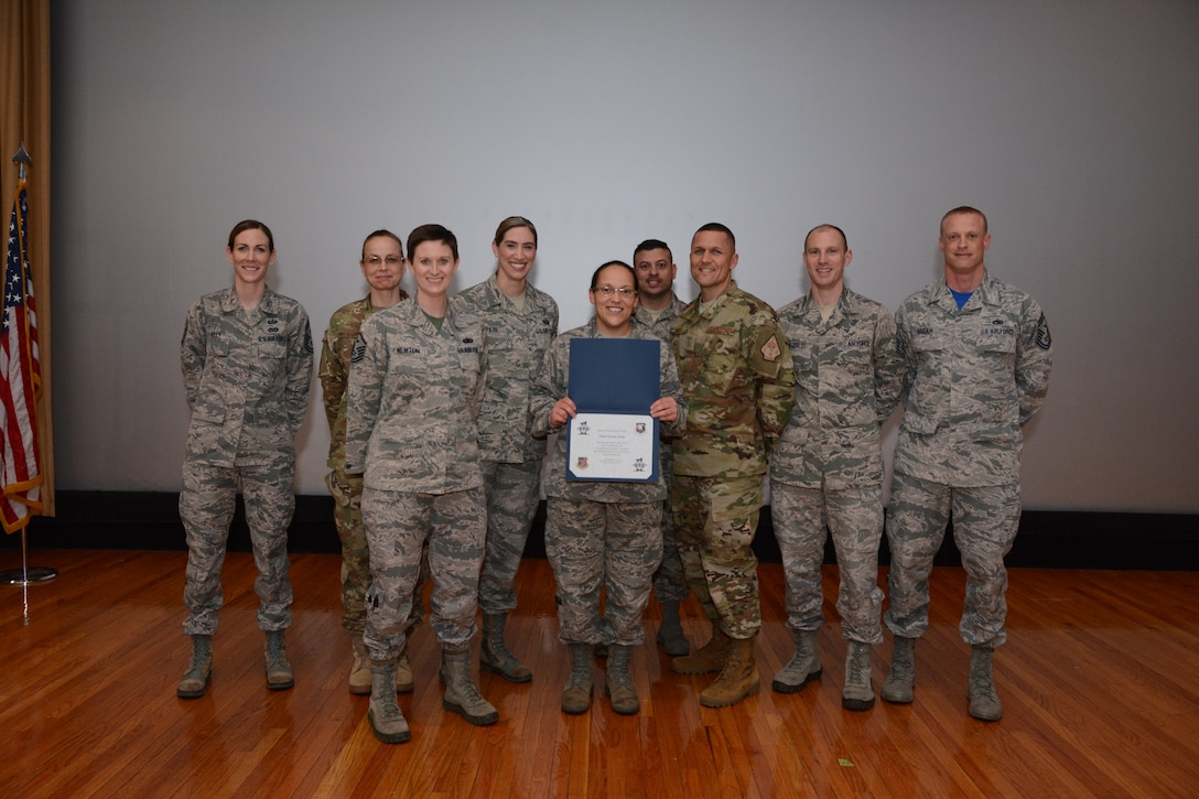 The 507th First Sgts. Council presents the Diamond Sharp award to Master Sgt. Librada Smith, 507th Air Refueling Wing command post, for her exceptional performance Feb. 10, 2019, at Tinker Air Force Base, Oklahoma. (U.S. Air Force photo by Tech. Sgt. Samantha Mathison)