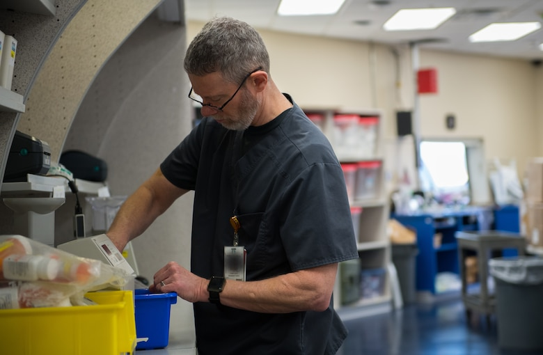 Larry Rusk, 2nd Medical Group Satellite Pharmacy technician, prepares medications at Barksdale Air Force Base, La., Feb. 5, 2019. The pharmacy process 300 to 400 new prescriptions every day. This photo has been altered for security purposes. (U.S. Air Force photo by Senior Airman Cassandra Johnson)