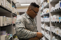 Senior Airman Franklin Graham, 2nd Medical Group Satellite Pharmacy technician, restocks shelves at Barksdale Air Force Base, La., Feb. 5, 2019. The pharmacy process 300 to 400 new prescriptions and 400 to 500 refills every day. (U.S. Air Force photo by Senior Airman Cassandra Johnson)