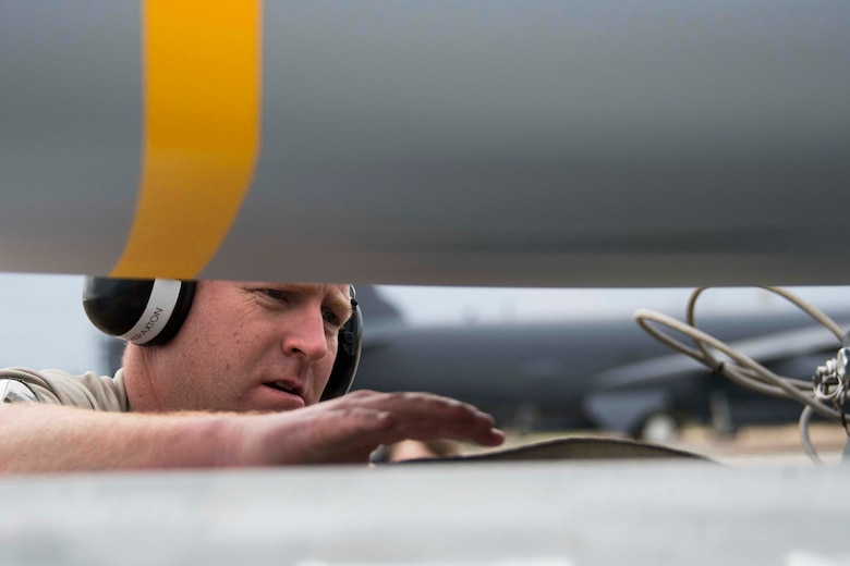 U.S. Air Senior Master Sgt. John Paxton, 307th Aircraft Maintenance Squadron aircraft armament systems superintendent, inspect an AGM-158 Joint Air-to-Surface Standoff Missile prior to loading on a Conventional Rotary Launcher at Barksdale Air Force Base, Louisiana, Feb. 6, 2019.  The JASSM's were part of a test conducted by Reserve Citizen Airmen and active duty to see if upgrades to the CRL would allow it to power eight of the munitions simultaneously.  (U.S. Air Force photo by Master Sgt. Ted Daigle)