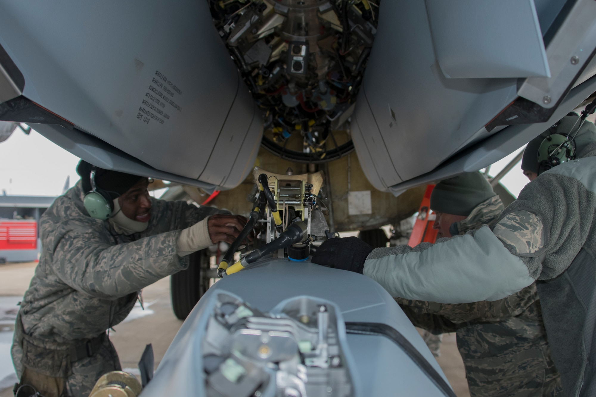Aircraft armament systems specialists assigned to the 307th Aircraft Maintenance Squadron unload an AGM-158 Joint Air-to-Surface Standoff Missile from a Conventional Rotary Launcher at Barksdale Air Force Base, Louisiana, February 9, 2019. The munitions were placed on the CRL by Reserve Citizen Airmen during a test to see if the weapons platform could power on eight JASSM's at one time.  (U.S. Air Force photo by Airman 1st Class Maxwell Daigle)