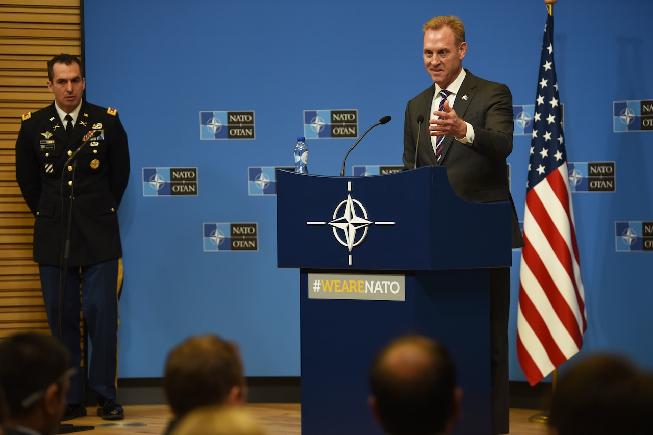 Acting Defense Secretary Patrick M. Shanahan speaks from behind a lectern.