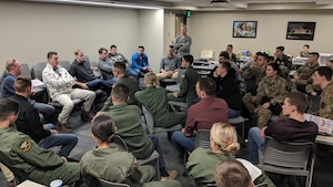 Virginia Tech Air Force ROTC Detachment 875 cadets chat with instructor pilots from the 37th and 48th Flying Training Squadrons from Columbus Air Force Base, Mississippi, Feb. 8, 2019, in Blacksburg, Virginia. The IPs hosted a social in the dorms, where cadets could ask questions about pilot life and their experiences. (Courtesy photo)