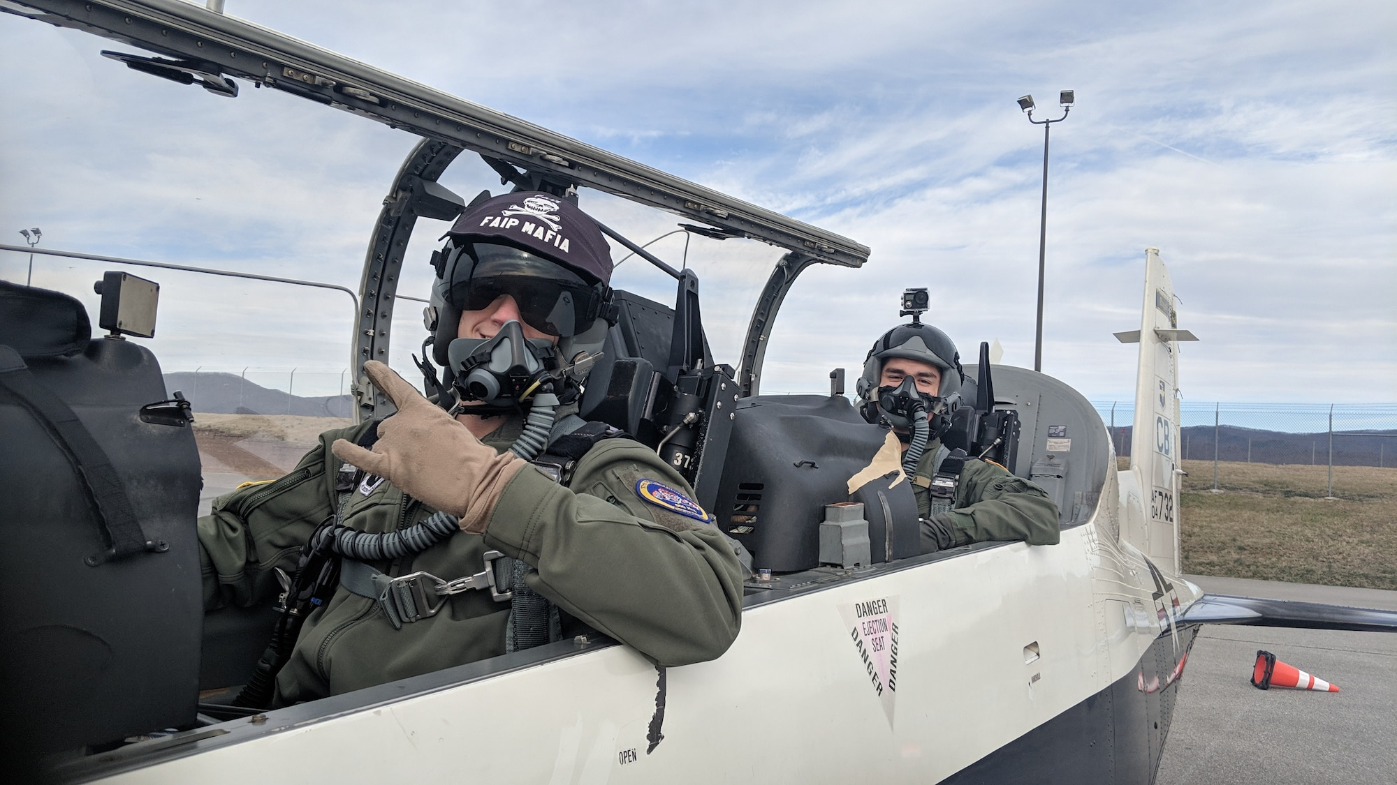 Capt. Andrew Barstow, 37th Flying Training Squadron assistant chief of training, and Cesar Ibarra Jr., Virginia Tech Air Force ROTC Detachment 875 cadet, pose for a photo before a sortie in a T-6 Texan II, at Roanoke Blacksburg Regional Woodrum Field, Virginia. In addition to working with instructor pilots, cadets were exposed to static displays, major weapons system briefs, and Q-and-A sessions with a team of aircrew flight equipment personnel and the 14th Medical Group flight surgeon from Columbus Air Force Base, Mississippi. (Courtesy photo)
