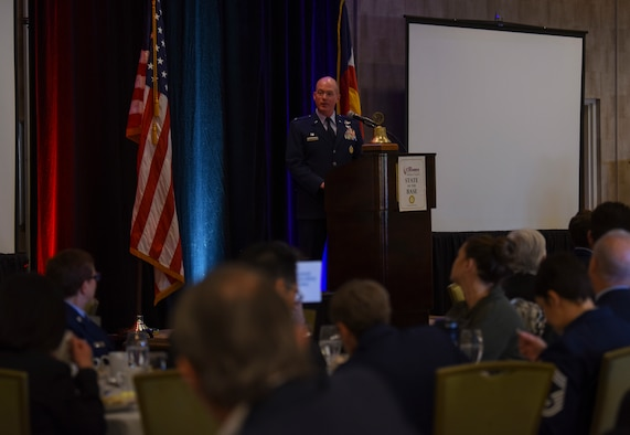 Col. Troy Endicott, 460th Space Wing commander, speaks to community members during the 2019 State of the Base Feb. 13, 2019, at the DoubleTree Hotel in Aurora, Colorado. During his speech, Endicott briefed the audience on the economic impact Buckley Air Force Base has on the community, as well as assured them the mission of the 460th SW is stronger than ever before. (U.S. Air Force photo by Senior Airman Holden S. Faul)