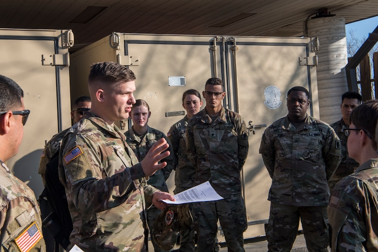 Army Capt. Corey Gunderson, 50th Expeditionary Signal Battalion Delta Company commander, gives a briefing Feb. 7, 2019 at Joint Base Charleston, S.C.