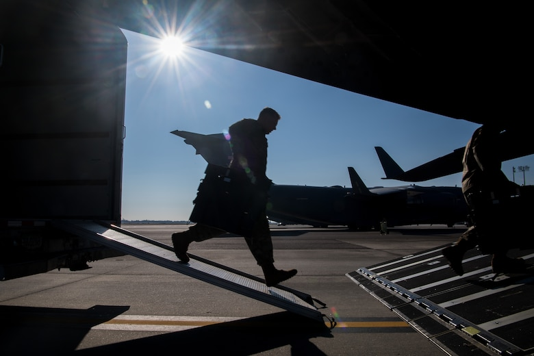 Army Sgt. William Suehn, 50th Expeditionary Signal Battalion key leader enroute node team chief, pulls communications equipment onto a C-17 Globemaster III Feb. 7, 2019, at Joint Base Charleston, S.C. Suehn and fellow Soldiers trained at JBC to become certified in t