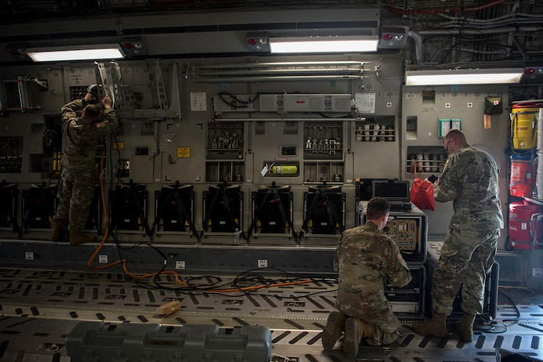 Soldiers from the 50th Expeditionary Signal Battalion set up communications systems in a C-17 Globemaster III Feb. 7, 2019, at Joint Base Charleston, S.C.