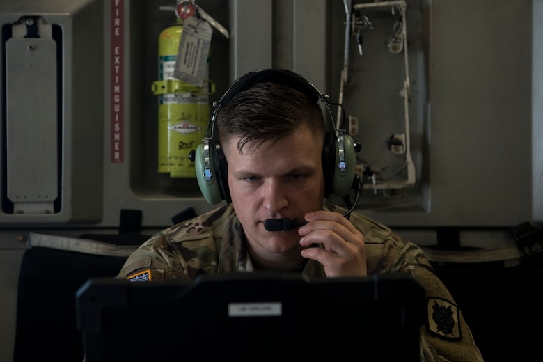 Army Capt. Corey Gunderson, 50th Expeditionary Signal Battalion Delta Company commander, tests the in-flight communications system in a C-17 Globemaster III after a team finished their certification training Feb. 7, 2019 at Joint Base Charleston, S.C.