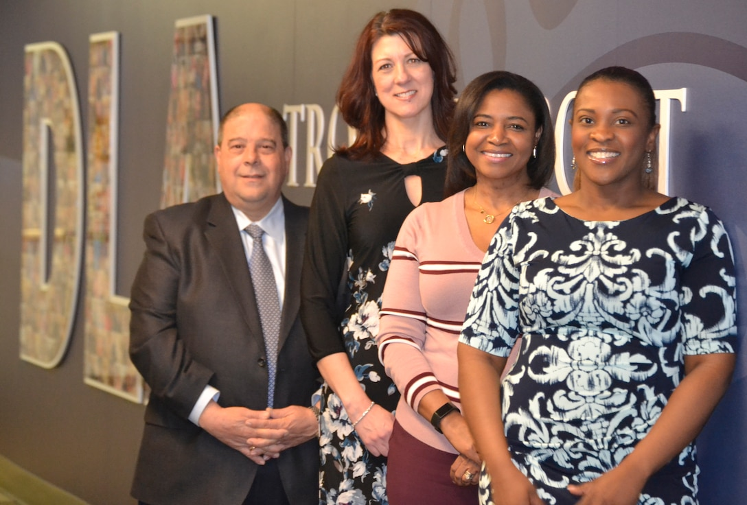 DLA Troop Support Procurement employees Nate Prattico, Eileen Friel, Raeshon Falkowski and Joan Estelly ,left to right, pose outside of the Procurement office during an appreciation ceremony Feb. 6, 2019 in Philadelphia.