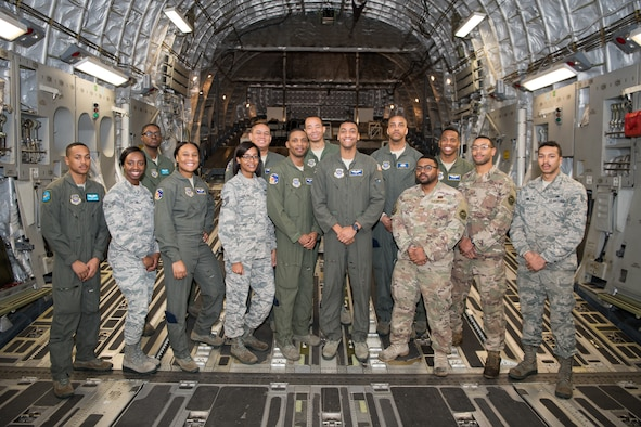 Airmen of the 3rd and 9th Airlift Squadrons who made up the flight crew for the African-American Heritage Flight Feb. 12, 2019, at Dover Air Force Base, Delaware. The flight was aimed at supporting the U.S. Air Force initiative to increase diversity and celebrate African-American History Month. (U.S. Air Force photo by Mauricio Campino)