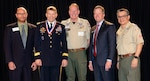 U.S. Army North Commanding General, Lt. Gen. Jeffrey Buchanan (second from left) was presented the Distinguished Eagle Scout Award at the Boy Scouts of America, Alamo Area Council Brunch Feb. 13 in San Antonio. Buchanan, who attained the rank of Eagle Scout in 1973, was presented this award for exceptionally distinguished service in his military career and to the community. Only one in every 1,000 Eagle Scouts has been awarded this high honor. Pictured (from left to right) are Mike Crownover, National Eagle Scout Association Chairman; Lt. Gen. Jeffrey Buchanan; Jim Lynch, Alamo Area Council Commissioner; Jim Jeffrey, Alamo Area Council President; and Michael de los Santos, Alamo Area Council Scout Executive.