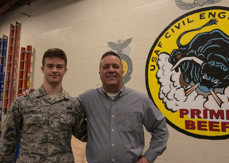 Airman 1st Class John Donnelly, III poses of the 103rd Civil Engineer Squadron poses for a photo with his father, Master Sgt. (Ret.) John Donnelly, II, February 10, 2019 at Bradley Air National Guard Base, East Granby, Conn. The senior Donnelly, an OSHA Federal Compliance Officer, coordinated with members of 103rd CES to conduct OSHA training for 40 members of the squadron. (U.S. Air National Guard photo by Tech. Sgt. Tamara R. Dabney)